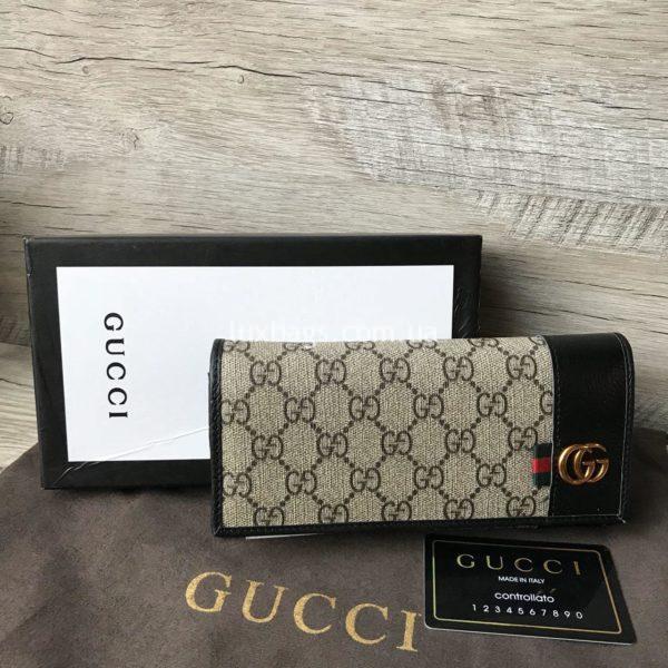 кошелек Gucci на кнопке фото
