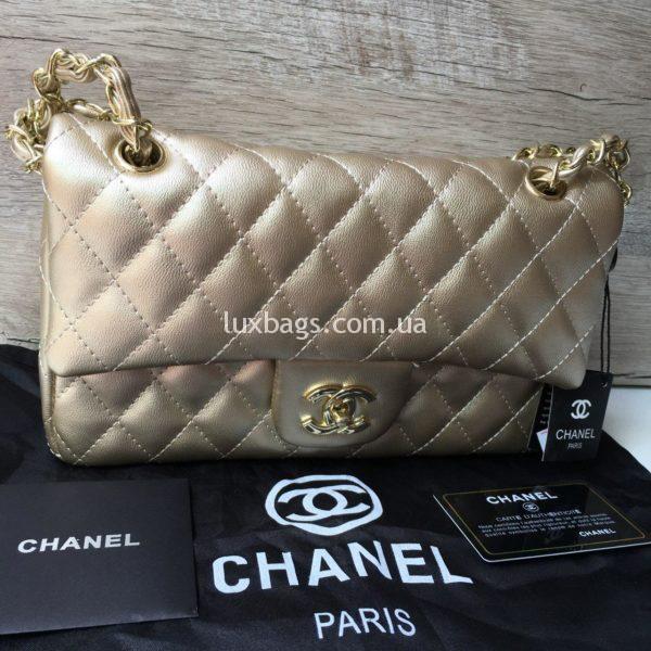 Женская сумка Chanel 2.55 Шанель золотая