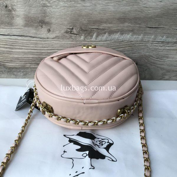 Женская круглая сумка Chanel Шанель розового цвета