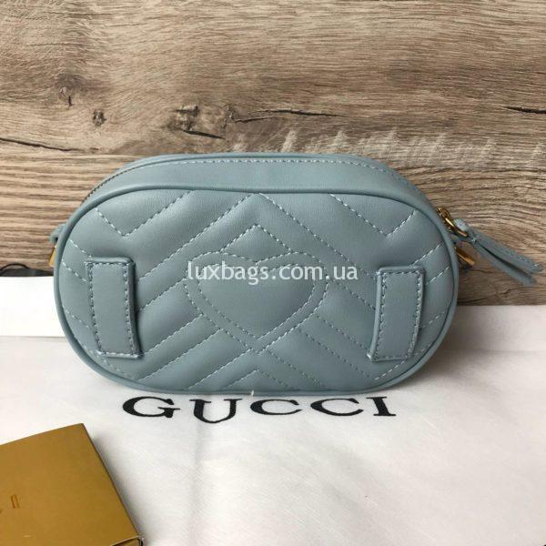 Сумка модели GG Marmont от Gucci на пояс голубая фото 1