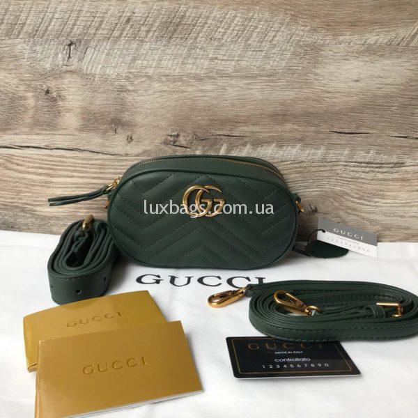 Сумка модели GG Marmont от Gucci на пояс зеленая