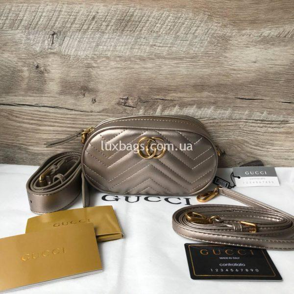 Сумка модели GG Marmont от Gucci на пояс бронзовая