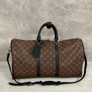 Модная дорожная сумка Louis Vuitton.